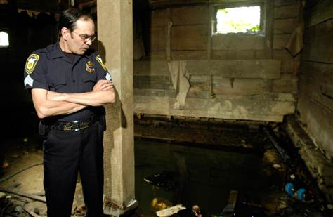 Kirtland police officer Sgt. Ron Andolsek stands in the barn where Jeffrey Lundgren murdered a family of five.