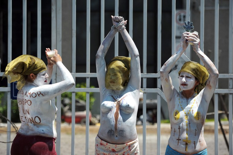 Members of feminist organizations demonstrate in favor of abortion outside the courthouse of San Salvador on May 15, 2013. Jose Cabezas/AFP